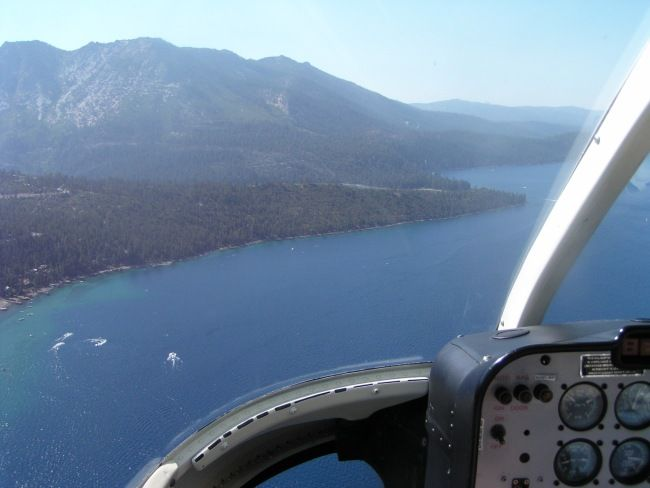 Cockpit of helicopter over coast