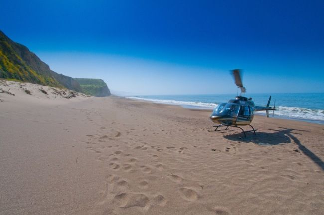 Helicopter landing at beach