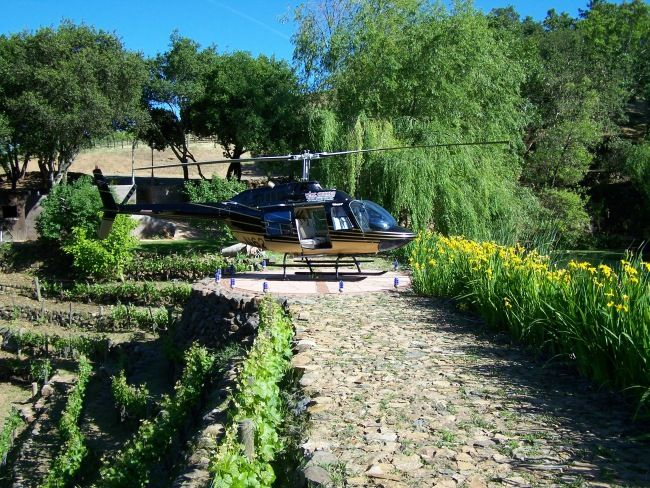 Helicopter landing at private winery walkway