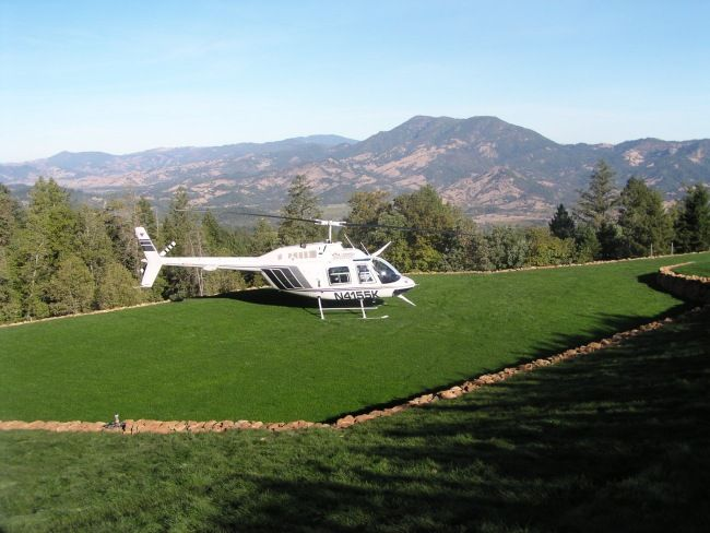 Helicopter landing at private field