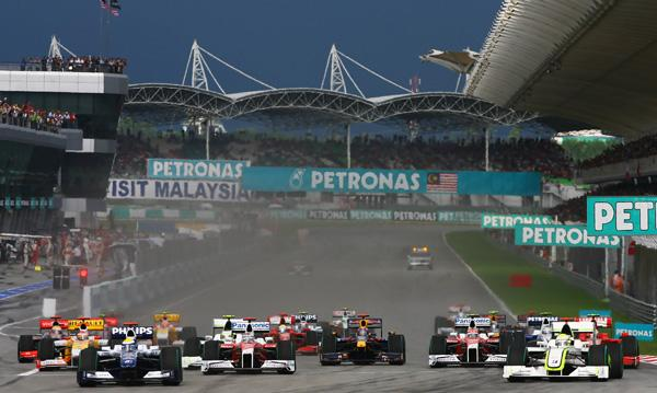 Nico Rosberg (far left) of Germany and Williams overtakes Jenson Button (far right) of Great Britain and Brawn GP to take the lead at the first corner at the start of the Malaysian Formula One Grand Prix.